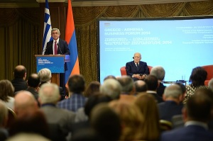 Armenian President Serzh Sarkisian speaks during a press conference with Greek President Karolos Populias (seated)